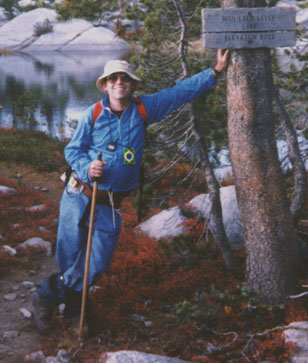 Larry pauses beside a trail marker high in the Sierra Nevada.  At peace with the world.